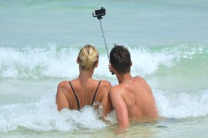 Couple taking selfie 300x200 - 9 ways computer science has had a positive impact on society
